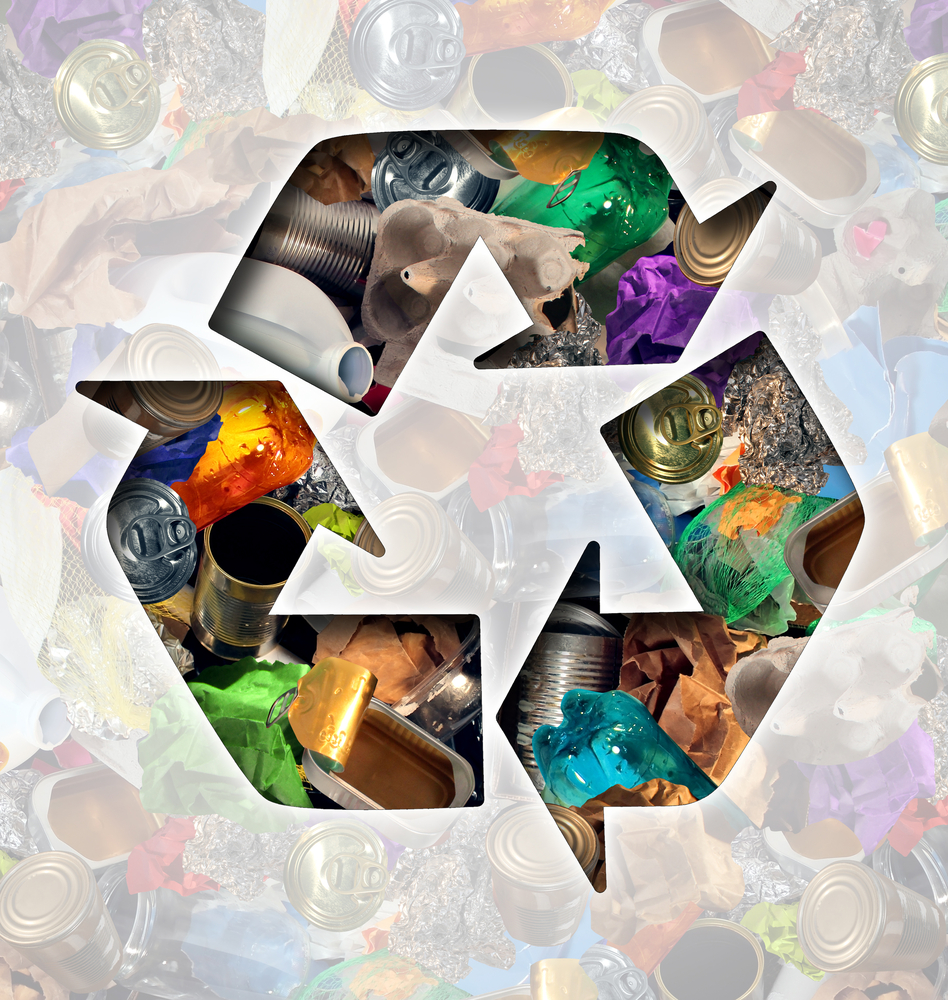 recycling symbol superimposed over image of trash