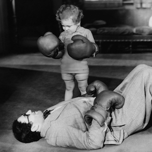 retro image of a boy in boxing gloves