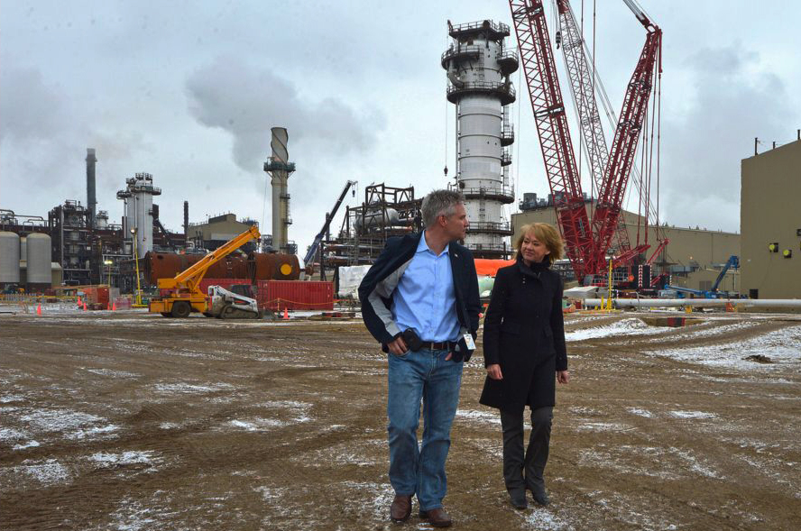 Alberta Minister of Energy Diana McQueen and Conservative MP Mike Lake tour the Quest Carbon Capture and Storage facility at Shell's Scotford plant near Fort Saskatchewan on April 17, 2014. The project is retrofitting the Scotford bitumen upgrader for carbon capture, designed for up to 1.2 million tonnes of CO2 captured per year, piped 80 kilometers north and injected more than two kilometers below the Earth's surface. (Photo by Chris Schwarz courtesy Government of Alberta) Public Domain