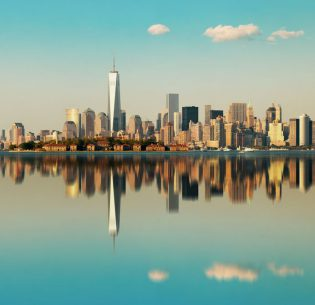 35720954 - manhattan downtown skyline with urban skyscrapers over river with reflections.