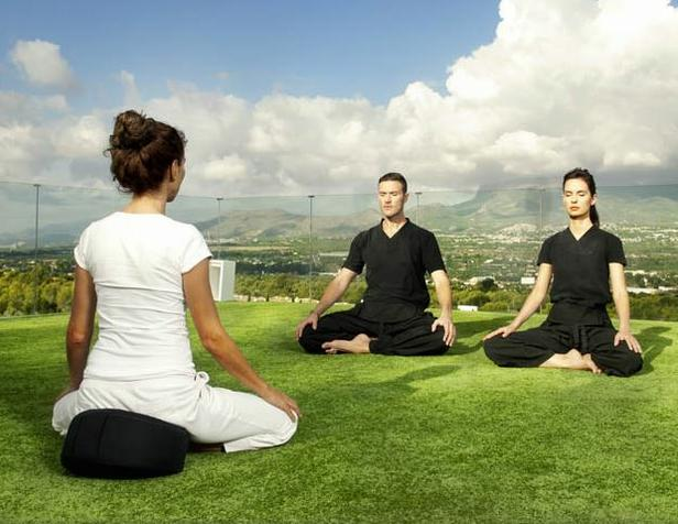 Meditation on a rooftop overlooking the Mediterranean Sea at SHA Wellness Clinic (Photo courtesy healthandfitnesstravel.com)