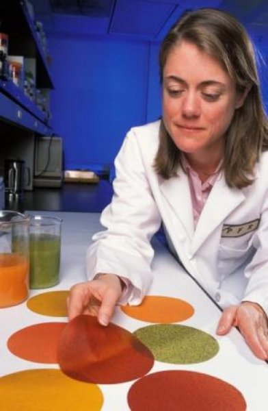 USDA chemist Tara McHugh displays edible food wraps designed to slow the spoilage of fresh fruits and vegetables. Similar wraps developed by McHugh also kill E. coli. (Photo courtesy American Chemical Society) Posted for media use