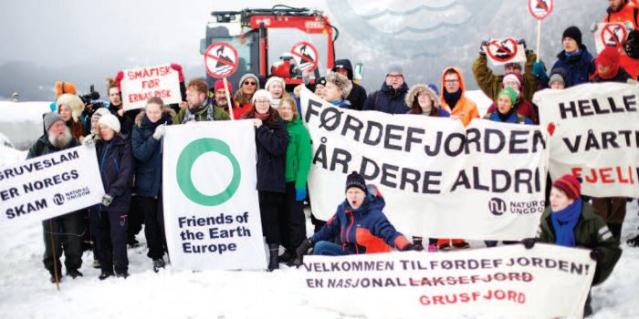 Caption: Standing in solidarity with Young Friends of the Earth Norway, to save Norway's fjords, 2016. (Photo © Luka Tomac / Friends of the Earth Europe) Published in FOE Europe 2016 Annual Review.
