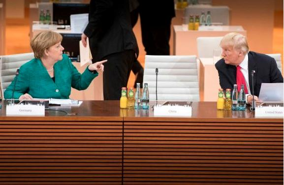 German Chancellor Angela Merkel makes a point to U.S. President Donald Trump, Hamburg, Germany, July 8, 2017 (Photo by Bundesregierung / Bergmann) Posted for media use.