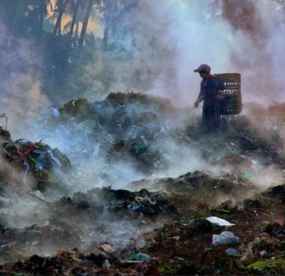 A girl searches for recyclable materials in a garbage dump with smelly gases rising around her. Mandalay City, Myanmar, February 2009 (Photo by Nyaung U courtesy UN Development Programme Global Photo Contest in China) Creative Commons license via Flickr