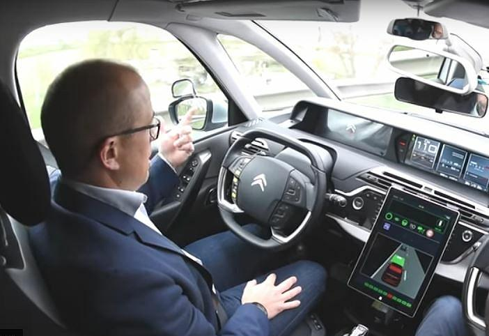 Non-expert driver takes the wheel of a PSA self-driving car for the first time in Europe at Velizy, France, the PSA Group's Technical Center. March 28, 2017 (Screengrab from video courtesy PSA) posted for media use