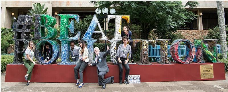 Assembly participants have fun with the #BeatPollution sculpture in front of the conference venue. December 5, 2017 (Photo courtesy Earth Negotiations Bulletin) Posted for media use