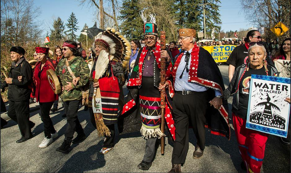 "Thousands gathered in Metro Vancouver, British Columbia, Canada for an Indigenous-led ""Protect the Inlet"" mass mobilization against the Kinder Morgan Trans Mountain Expansion pipeline, dozens were arrested. March 10, 2018. (Photo by Zack Embree) Creative Commons license via Flickr"