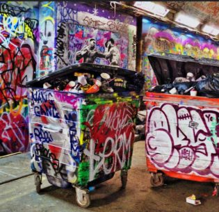 Tagged wheelie bins in London, England, July 16, 2017. (Photo by Tee Cee) Creative Commons license via Flickr