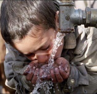 AfghanBoyDrinking