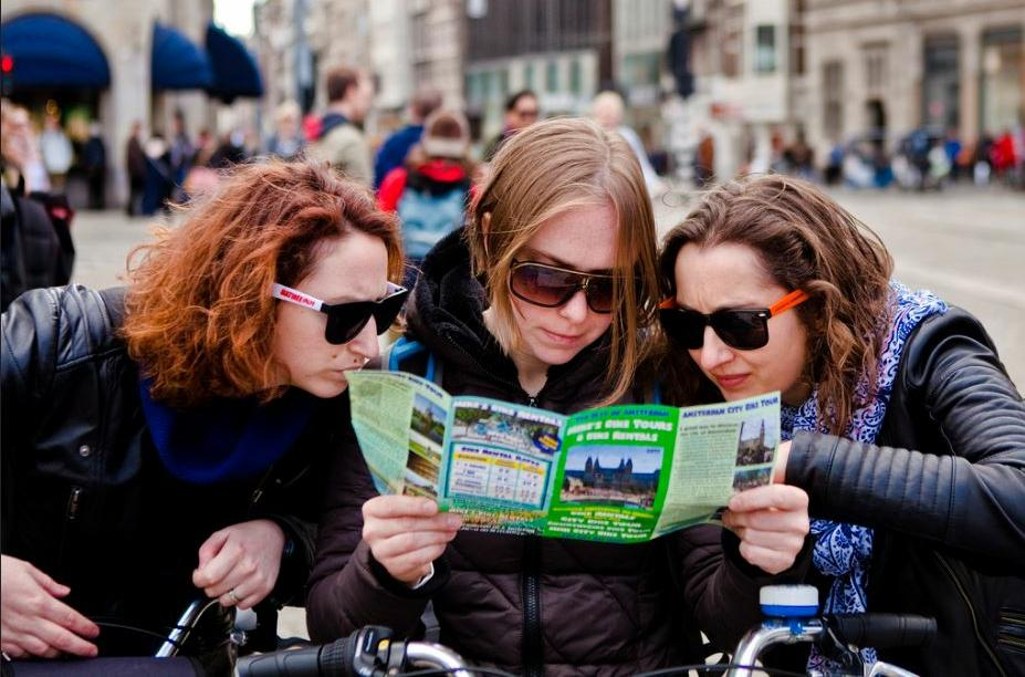 Visitors to The Netherlands explore Amsterdam by bicycle, April 7, 2017 (Photo by Huub Zeeman) Creative Commons license via Flickr