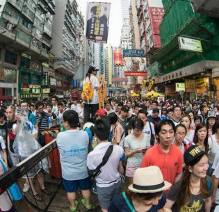 Crowd in Hong Kong, July 1, 2014 (Photo by doctorho) Creative Commons license via Flickr
