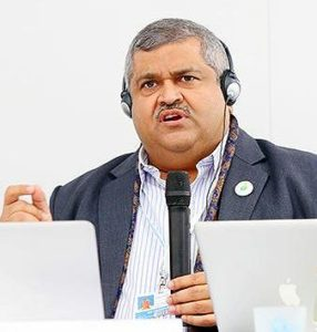 Satya Tripathi, UN assistant secretary-general, UN Environment, speaking at COP21, the 21st session of the Conference of the Parties to the UN Framework Convention on Climate Change, UNFCCC COP21; where the Paris Agreement on climate was finalized unanimously by world leaders. Paris, France December 7, 2015., Photo courtesy Earth Negotiations Bulletin) Used with permission.