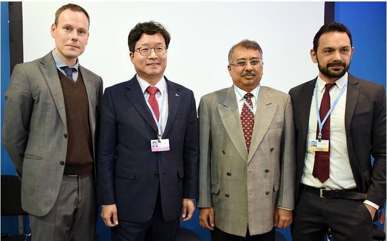 Men's fashions from around the world at COP24 in Katowice, Poland. From left, Rasmus Valanko, World Business Council on Sustainable Development; Yeom Tae-young, Mayor of Suwon, Republic of Korea, on behalf of ICLEI's Ecomobility Alliance; Anirban Ghosh, Mahindra; and Nicola Tagliafierro, Head of Sustainable Product Development, Enel; Dec. 10, 2018 (Photo courtesy Earth Negotiations Bulletin) Used With Permission