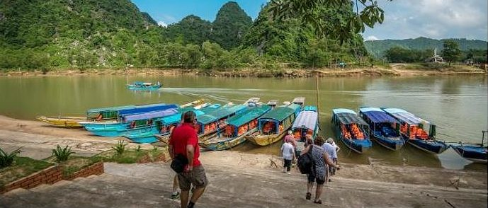 Blue boats transport tourists going to Phong Nha, Vietnam. The wharf was funded by the Asian Development Bank's Greater Mekong Subregion Sustainable Tourism Development Project, giving local people more work opportunities. (Photo courtesy Asian Development Bank)