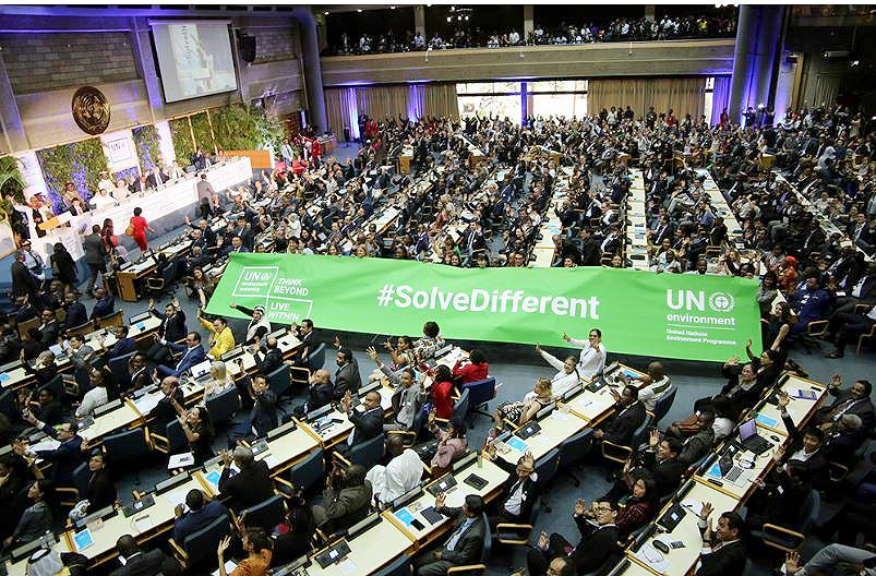 A banner expressing the meeting's intention to create innovative solutions to environmental problems is carried into the meeting hall at UN Environment Headquarters during the UNEA-4 High Level Segment, Nairobi, Kenya, March 14, 2019. (Photo courtesy Earth Negotiations Bulletin) Used with permission.
