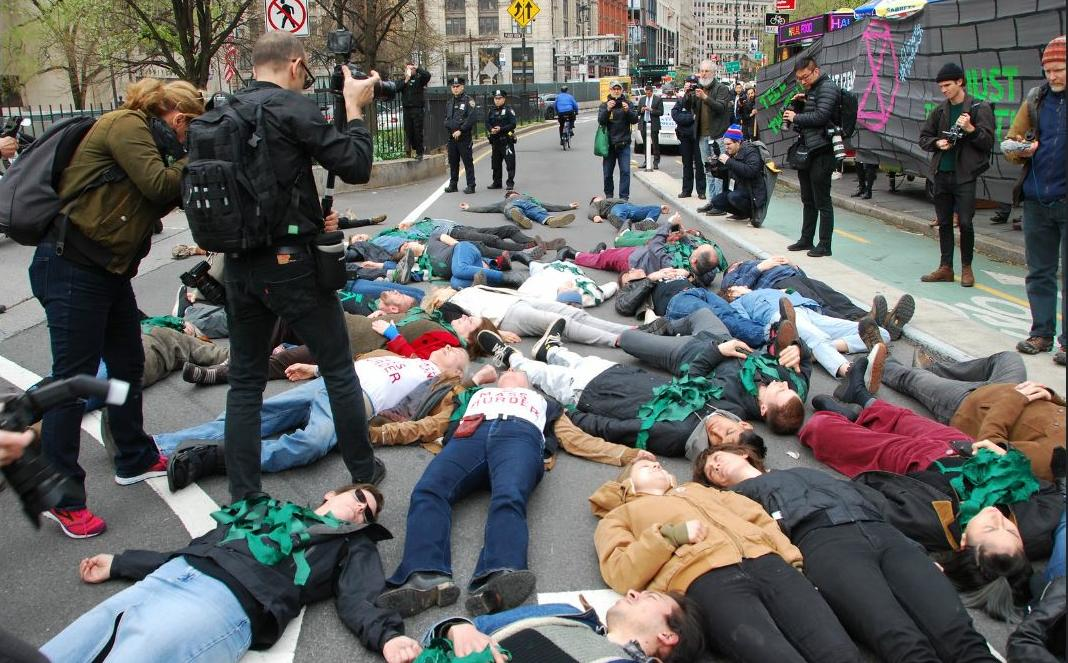 Extinction Rebellion die-in in front of New York City Hall. April 17, 2019 (Photo by Felton Davis) Creative Commons license via Flickr.