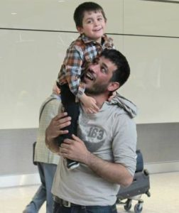 Khaled is reunited with his son at the airport under the IOM-British Red Cross Family Reunification program. 2019 (Photo courtesy British Red Cross) Posted for media use