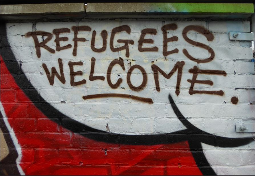 Graffiti welcomes refugees, London, UK, 2015 (Photo by Duncan C) Creative commons license via Flickr
