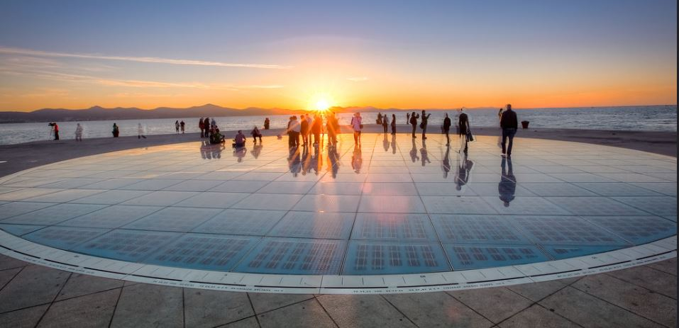 The Greeting to the Sun consists of 300 multi-layer glass panels set into the quay paving in a circle 22 meters in diameter. Beneath the conducting glass panels are photovoltaic solar modules providing symbolic communication with nature. October 24, 2012, Zadar, Croatia. (Photo by Tim Ertl) Creative Commons license via Flickr