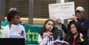 Child migrants speak of their experiences at a demonstration to honor all immigrants in front of the San Francisco office of U.S. Senator for California Kamala Harris, a Democrat, led by the Interfaith Movement for Human Integrity, April 18, 2019 (Photo by Peg Hunter) Creative Commons license via Flickr