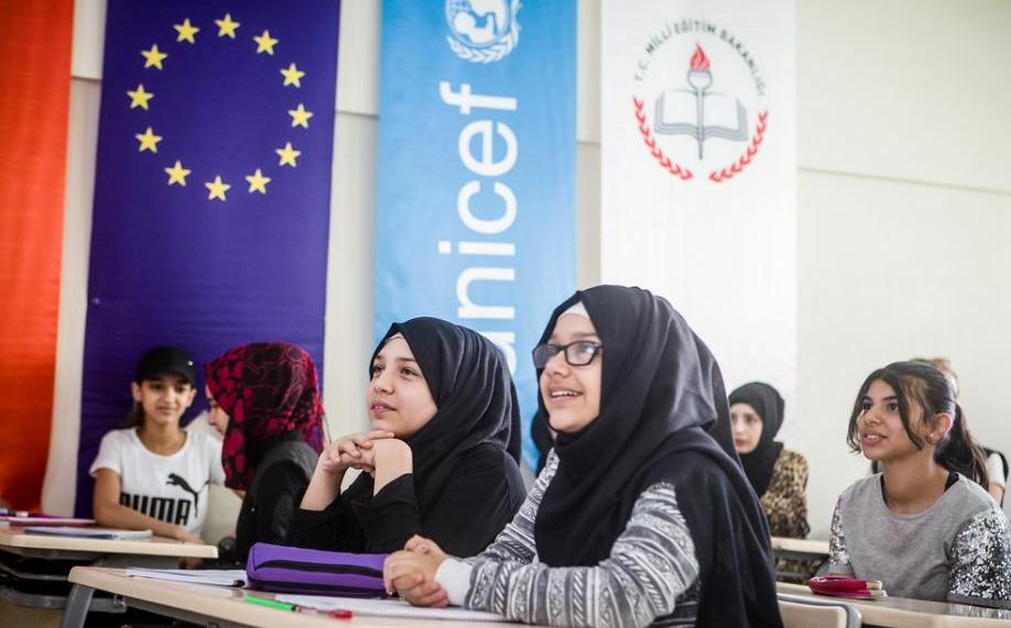 Syrian refugee girls who wait until after they are 18 to be married sometimes get to go to school. These girls are listening to a Turkish lesson in an Accelerated Learning Programme classroom in Haliliye Public Education Centre supported by European Union funding. September 26, 2018 (Photo by EU Civil Protections and Humanitarian Aid Operation) Creative Commons license via Flickr