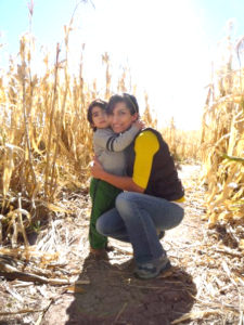 Professor Rana Abudayyeh and her son, Jason, in a New Mexico cornfield, 2017 (Photo courtesy University of Tennessee)