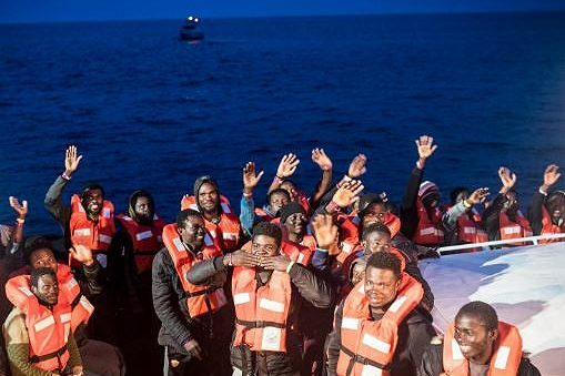 Some of the 47 rescued people onboard the NGO operated rescue ship Sea-Watch 3 wave for the camera. They were disembarked safely, and in close cooperation with the Italian Coast Guard, on the island of Lampedusa in the Mediterranean Sea between Sicily and Tunisia. May 19, 2019 (Photo courtesy Sea-Watch) Posted for media use