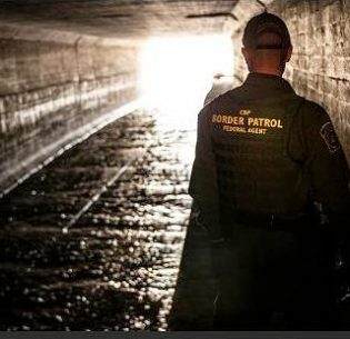 U.S. Customs and Border Patrol agent inspects a drainage tunnel that runs from Nogales, Arizona to Mexico. (Photo by Josh Denmark courtesy U.S. Customs and Border Protection) Public domain.