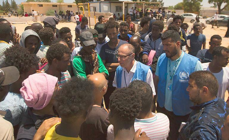 UNHCR Chief of Mission for Libya, Jean-Paul Cavalieri (center in blue vest, glasses), takes statements from officials, refugees and migrants after arriving at Tajoura Detention Centre, July 3, 2019 (Photo by Mohamed Alalem / UNHCR)