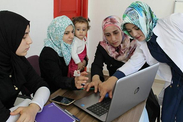 Refugee women take a computer course in the SADA Women-only Center in Gaziantep, Turkey. September 16, 2017 (Photo courtesy UN Women) Creative Commons license via Flickr