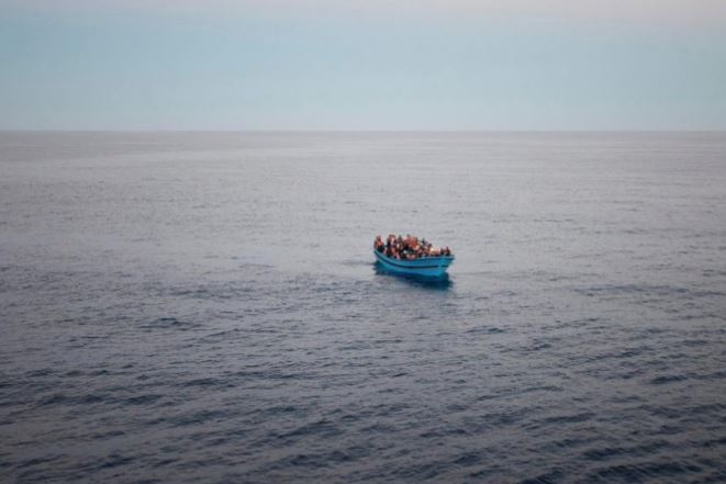 Refugees from Africa try to cross the Mediterranean in an overloaded boat to reach Europe. Refugee boat was seen from the deck of the Italian Coastguard ship, the San Giorgio, during a Mediterranean patrol in 2014.  (Photo by Alfredo D'Amato / UNHCR) Posted for media use.