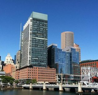 Boston's Atlantic Wharf (tallest building, center) is the city's first LEED platinum skyscraper with offices, retail and residential lofts on Boston's waterfront. LEED, Leadership in Energy and Environmental Design, is a national certification system developed by the U.S. Green Building Council to encourage the construction of energy and resource-efficient buildings. Platinum is the highest LEED rating given. September 2013 (Photo courtesy U.S. Green Building Council) Posted for media use