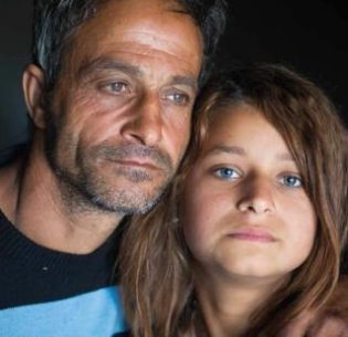 Stateless father Mivtar Rustemov, 48, and his daughter Lirije Rustemov, 13, in the city of Skopje, capital of the Former Yugoslav Republic of Macedonia, now known as North Macedonia. 2017 (Photo courtesy UNHCR) Posted for media use
