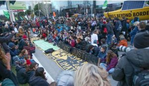 "As the negotiations continue behind closed doors inside the COP25 venue, members of the nonprofit climate action groups Extinction Rebellion and FridaysForFuture blocked the roads leading to the venue, staging a large protest, calling the meeting ""another lost opportunity."" December 11, 2019 (Photo courtesy Earth Negotiations Bulletin)"
