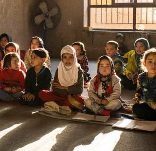 Children of trainee carpet weavers at an in-house kindergarten at the Afghan Bazar Carpet Company in Mazar-e Sharif, in northern Afghanistan's Balkh Province. December 3, 2019 (Photo courtesy International Labour Organisation Asia-Pacific) Creative Commons license via Flickr