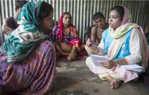 Caption: Rohingya refugee Rashida Begum, 23, left, receives counseling at Kutupalong refugee camp in Bangladesh. 2019 (Photo by Roger Arnold courtesy UNHCR)