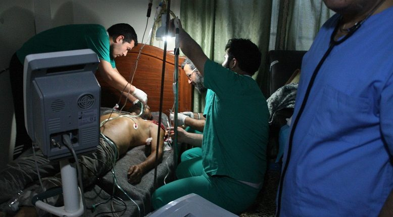 Caption: Medical team works to save a patient at a hospital in the Syrian town of Darat Izza, western Aleppo. March 13, 2020 (Photo courtesy Physicians for Human Rights) Posted for media use