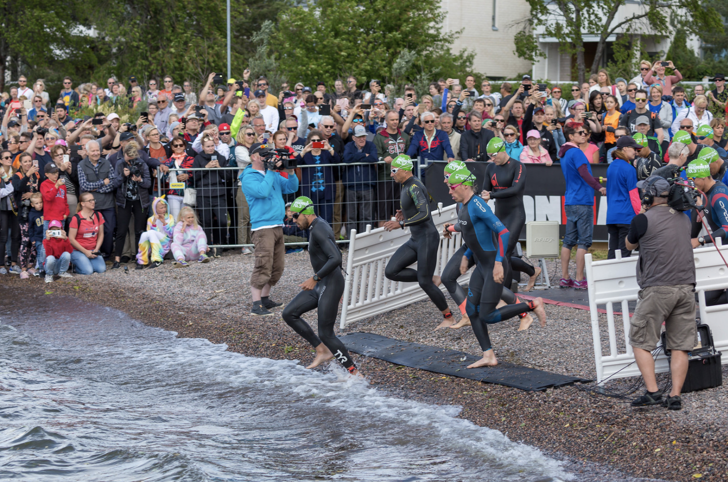In the world's happiest country, Finland, triathletes run into Lake Vesijärvi for their Ironman Swimming Competition, June 29, 2019 (Photo by Marco Verch) Creative Commons license via Flickr