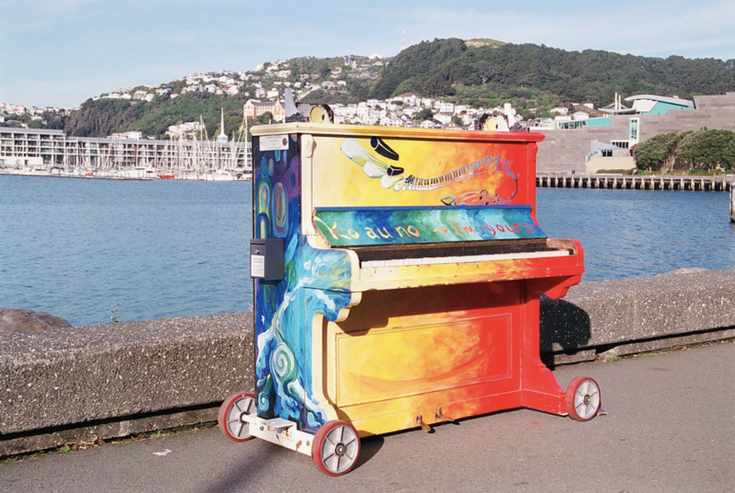 Anyone can walk up to and play this piano on a pier in Wellington, New Zealand, the world's third happiest city, August 2, 2019 (Photo by N.J. Cull) Creative Commons license via Flickr