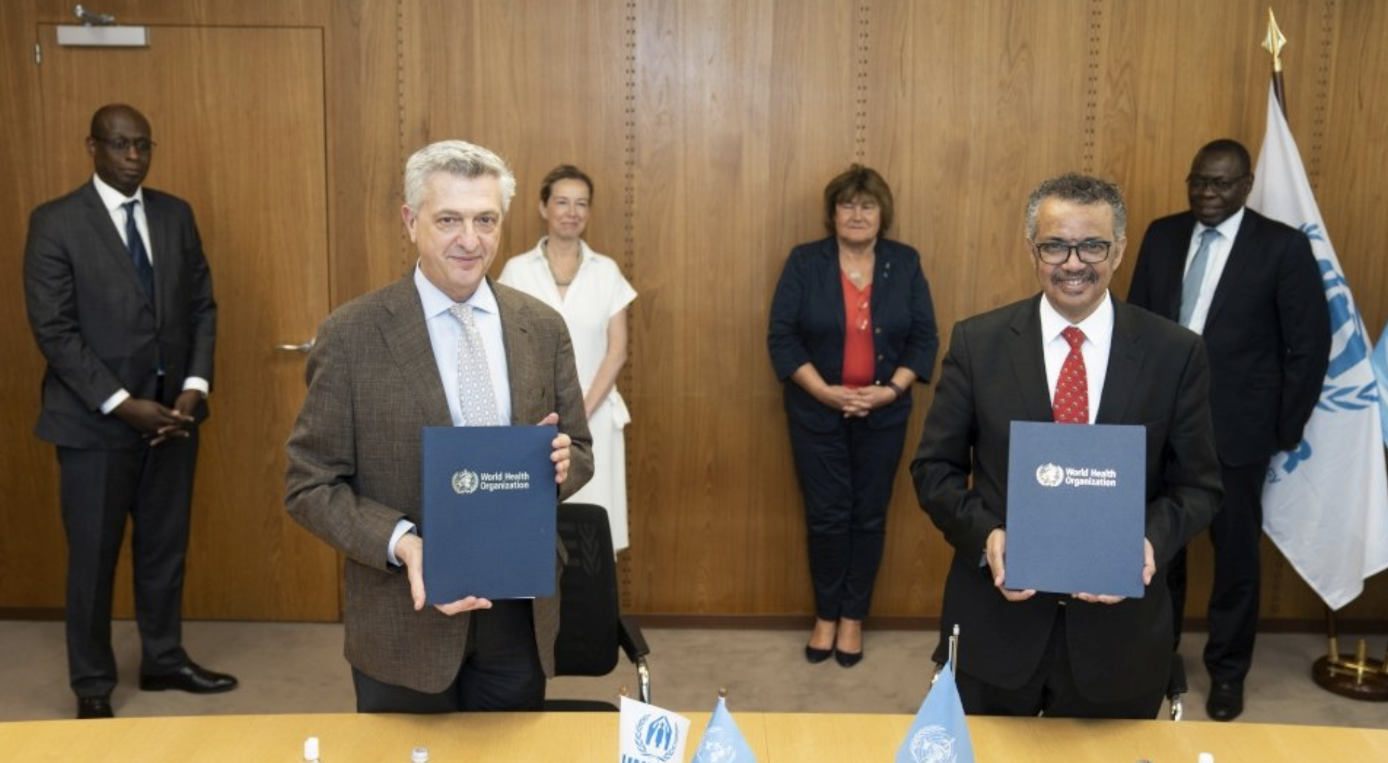 UN High Commissioner for Refugees Filippo Grandi (left) and Director-General World Health Organization Dr. Tedros Adhanom Ghebreyesus sign a Memorandum of Understanding on the integration of refugees in national health preparedness and response plans globally. May 21, 2020, Geneva, Switzerland (Photo by Christopher Black courtesy World Health Organization) Posted for media use