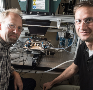 Scientists John Geisz, left, and Ryan France at the U.S. National Renewable Energy Laboratory have created a solar cell that is nearly 50 percent efficient. 2020 (Photo by Dennis Schroeder courtesy NREL) Posted for media use