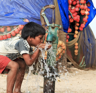 """I drink because I'm thirsty,"" says this boy who lives in the state of Tamil Nadu, India. March 20, 2016 (Photo by Nithi Anand) Creative Commons license via Flickr"