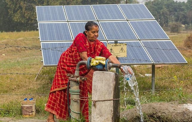 A farmer with her solar irrigation pump in Balahar Daha Village, Nepal, February 17, 2020 (Photo by Nabin Baral courtesy International Water Management Institute) Creative Commons license via Flickr