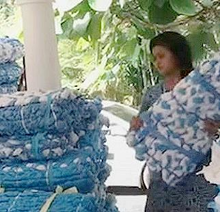 Fashion designer Laksmi Menon, founder of Pure Living, readies bedrolls for free distribution to First Line Treatment Centres and homeless shelters in the Indian state of Kerala. 2020 (Photo courtesy World Economic Forum via Shayya Facebook Page) Posted for media use
