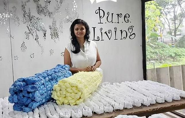 Caption: Fashion designer Laksmi Menon, founder of Pure Living, with the bedrolls she designed using plastic waste from the manufacture of personal protective equipment. 2020 (Photo courtesy Laksmi Menon via Facebook) Posted for media use