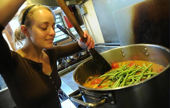 The cook smiles while preparing vegetarian green bean soup, Breitenbush Hot Springs, Breitenbush, Oregon, September 13, 2011 (Photo by Wonderlane) Public domain