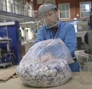 In his lab Edvin Ruuth, researcher in chemical engineering at Lund University, prepares to transform scraps of cotton into a sugar solution before turning that solution into a new textile, February 2021 (Screengrab from video courtesy Lund University) Posted for media use