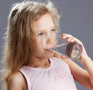 Child drinking water from a glass, February 16, 2016, Salt Lake City, Utah (Photo by Aqua Mechanical) Creative Commons license via Flickr