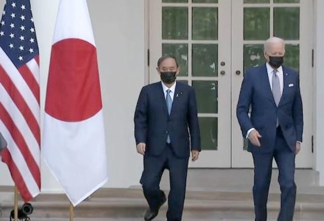 President Joe Biden, right, hosts Japanese Prime Minister Yoshihide Suga at the White House, his first in-person visit with a foreign leader since on January 20, 2021 when he assumed the presidency. The two leaders agreed to cooperate to solve the climate crisis. April 16, 2021, Washington, DC (Photo courtesy Voice of America) Posted for media use